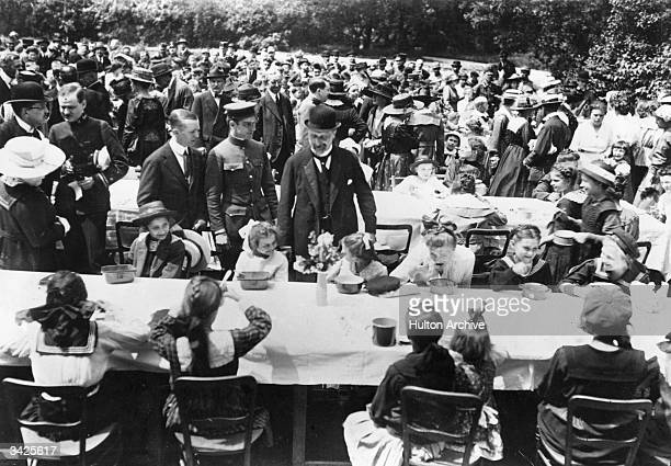 German and Austrian children being fed by Americans at a charity dinner