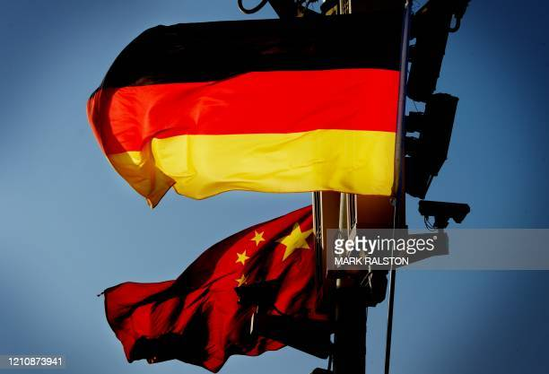 German and Chinese flags in Tiananmen Square on the eve of a twoday visit by German Chancellor Angela Merkel in Beijing on February 1 2012 The...