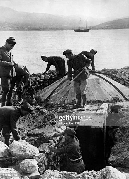 German and Italian soldiers building a bunker at a bay in Crete