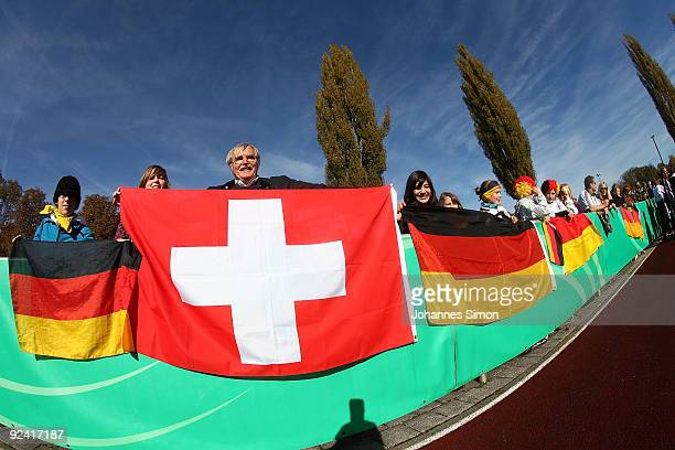 German and Swiss supporters display their national flags during the U16 international friendly match between Germany and Switzerland at the Iller...