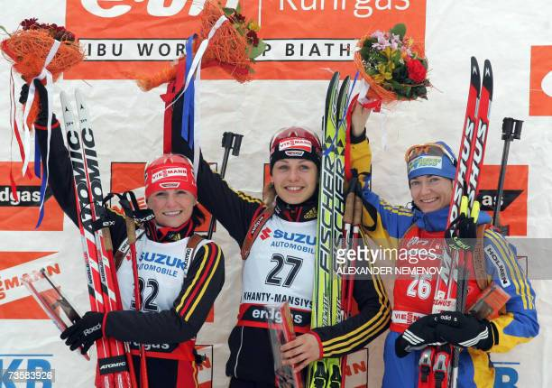 German Andrea Henkel who won the silver medal her compatriot and gold medalist Magdalena Neuner and thirdplaced Anna Chair Olofsen of Sweden wave on...