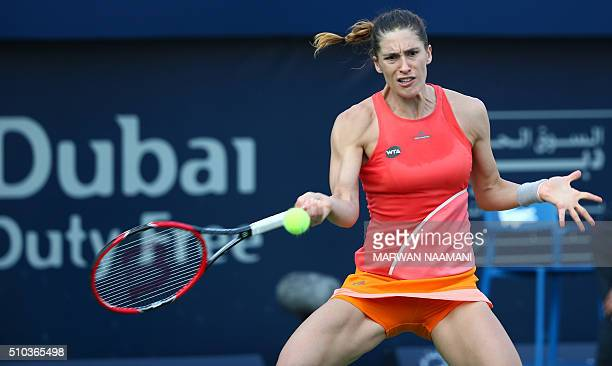 German Andrea Petkovic returns the ball to Italian Camila Giorgi during their WTA tennis match on the first day of the Dubai Duty Free Tennis...