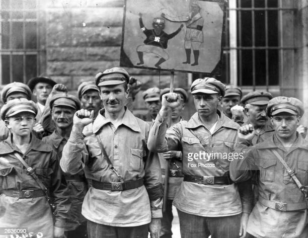 German anti-fascists give the clenched fist salute.
