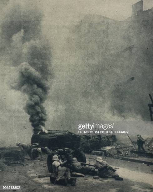 German anti-tank gun in the city of Bastogne, Belgium, World War II, photograph by Weltbild from L'Illustrazione Italiana, Year LXXII, No 2, January...