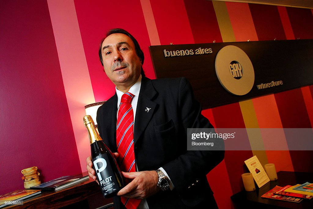 German Arballo, owner of the Buenos Aires Gay Wine Store, holds a bottle of Pilot Gay Wine in his store in Buenos Aires, Argentina, on Friday, Sept. 21, 2007. The 23 members of London's Stonewall FC all-gay soccer team will defend their world club title at a championship in Buenos Aires next week. They're also boosting the city's efforts to supplant Rio de Janeiro as Latin America's top destination for gay and lesbian travelers.