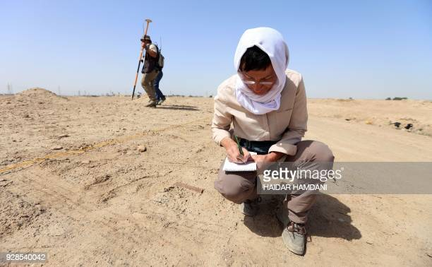 German archaeologists conduct research at the ancient preIslamic Arab site of AlHirah about 25 kilometres south of the Muslim holy city of Najaf on...