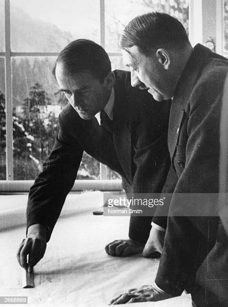 German architect Professor Albert Speer showing German dictator Adolf Hitler some of his plans for Berlin's new outline and buildings