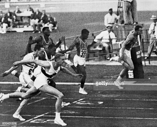 German Armin Hary crosses the finish line at the 100m at the athletics event of the Rome 1960 Olympic Games on September 1 1960 in Rome Armin Hary...