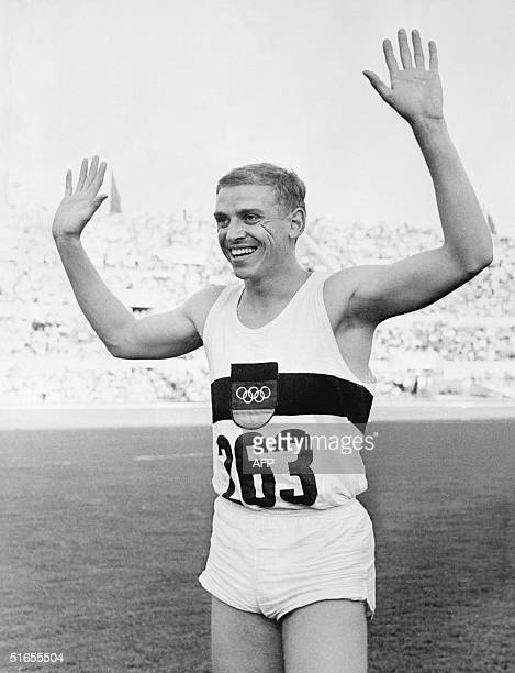 German Armin Hary waves to the public as he just crossed the finish line at the 100m during the Olympic Games in Rome 01 September 1960 Armin Hary...