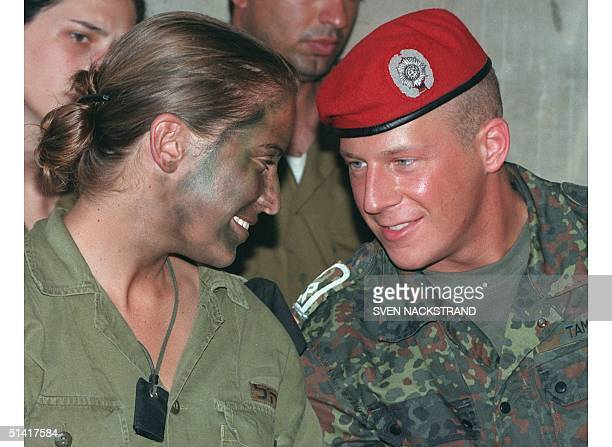 German army cadet Christian Tamminga from Berlin has a warm chat with Israeli female army soldier and sniper instructor Michal Dunajenski during a...