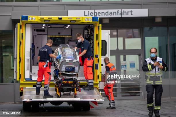 German army emergency personnel load portable isolation unit into their ambulance that was used to transport Russian opposition figure Alexei Navalny...