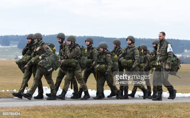 German army parachutist soldiers of the airborne and air transport group are pictured ahead of a demonstration during a visit of German Defense...