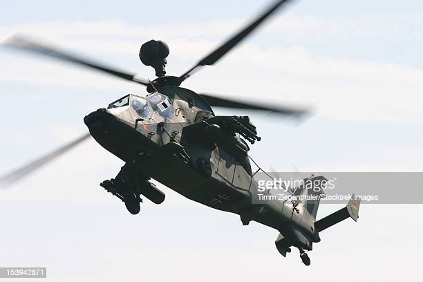 A German Army Tiger Eurocopter with gunpod, in flight over Germany.