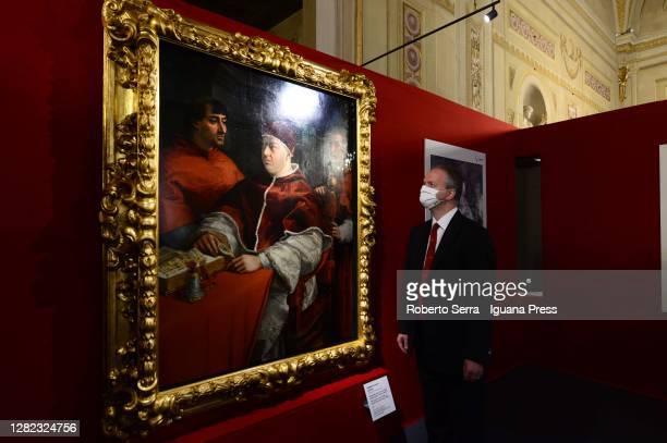 "German art historian Eike Schmidt Director of the Gallerie degli Uffizi and Palazzo Pitti museums poses with the Raffaello masterpiece ""Portrait Of..."