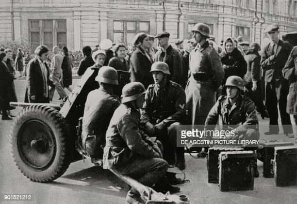 German artillery in a street in Kiev Ukraine World War II from L'Illustrazione Italiana Year LXVIII No 40 October 5 1941