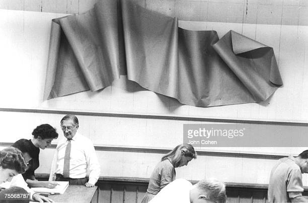 German artist and educator Josef Albers checks a student's work during as he teaches a class at Yale University New Haven Connecticut 1955