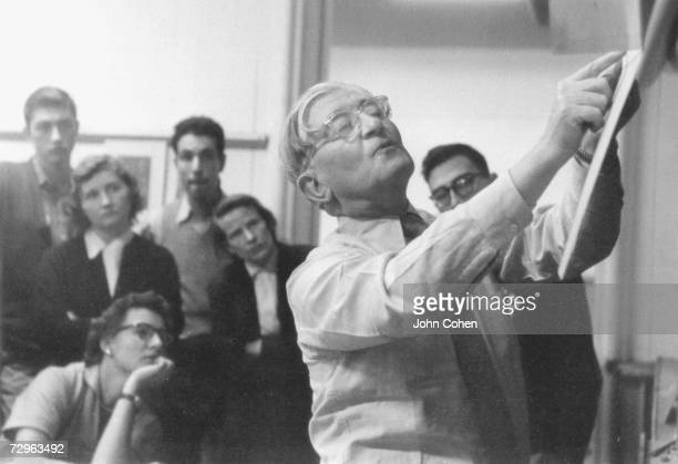 German artist and educator Josef Albers points to something as students look on during a class he teaches at Yale University New Haven Connecticut...