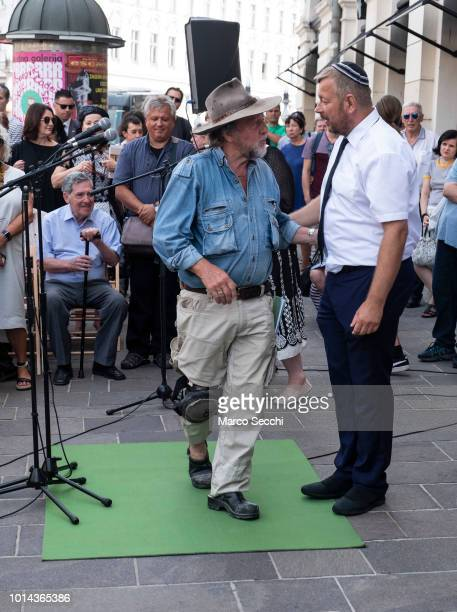 German Artist Gunter Demnig and Robert Waltl of the Jewish Cultural Centre Ljubljana during speaches ahead of the ceremony to lay a block...