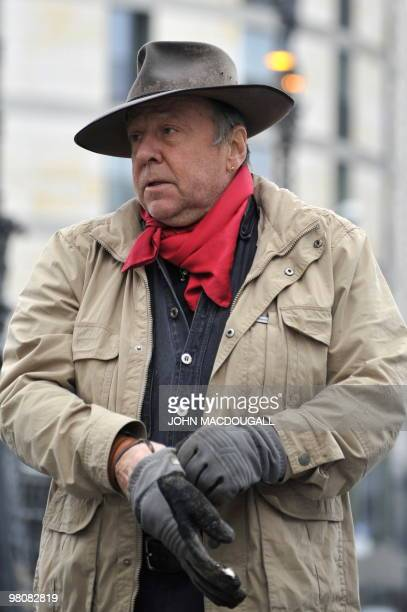 """German artist Gunter Demnig arrives to lay """"stolpersteine"""" or stumbling stones in Berlin's Friedrichstrasse March 27, 2010. The stones, topped with..."""