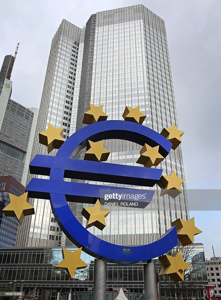 German artist Ottmar Hoerl 's sculpture depicting the Euro logo is seen in front of the European Central Bank (ECB) where a press conference is held following the meeting of the Governing Council in Frankfurt/Main, western Germany, on February 7, 2013. The ECB held its key interest rates unchanged at its policy meeting despite French concerns that the euro's recent strong rise could pose a threat to economic recovery. ROLAND