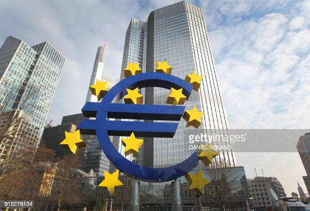 German artist Ottmar Hoerl's sculpture depicting the Euro logo is pictured in front of the former headquarter of the European Central Bank in...