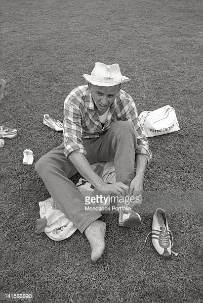 German athlete Armin Hary wearing a pair of Adidas shoes at prizegiving of 100metre sprint race Puma was his sponsor during the race Rome 1960