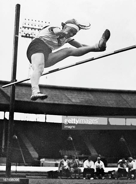 German athlete Grieme Selma at her victory in the high jump final of the Women's World Games at White City Stadium in London. August 10th 1934....
