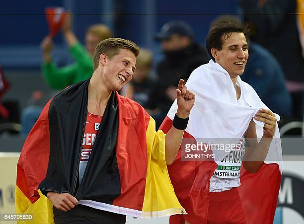 German athlete Max Hess and Polish athlete Karol Hoffman celebrate after the triple jump men final during the European Athletics Championships in...