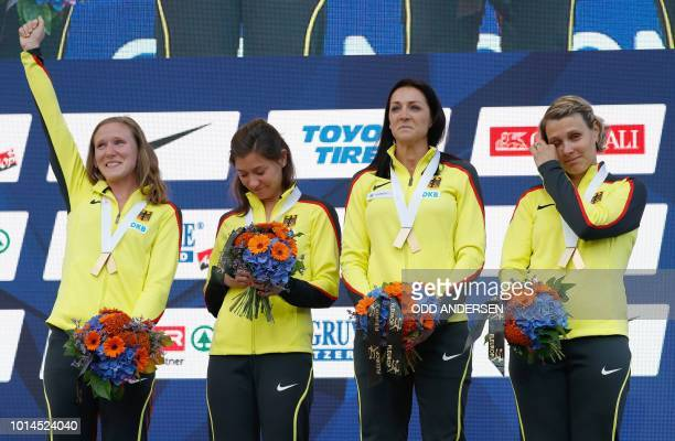 German athletes Fabienne Kohlmann, Esther Cremer, Janin Lindenberg and Claudia Hoffmann stand on the podium after they were given the gold medal for...