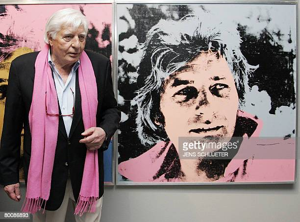 German author and photographer Gunter Sachs poses next to his portrait Gunter Sachs by Andy Warhol at the opening of an exhibition of his work Art is...