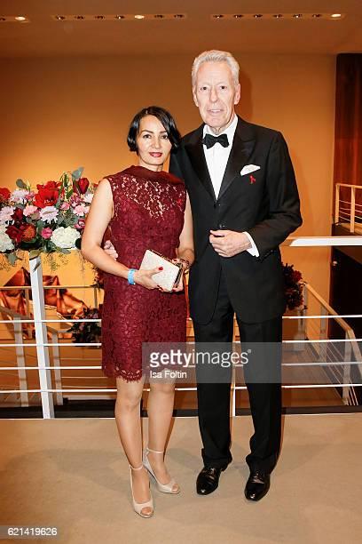 German author Egon F Freiheit and his girlfriend Amira arrive at the 23rd Opera Gala at Deutsche Oper Berlin on November 5 2016 in Berlin Germany