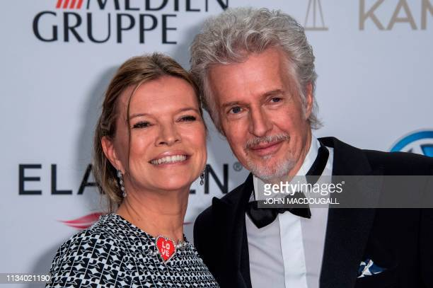 German author Frank Schaetzing and his partner Sabina Valkieser pose on the red carpet prior to the annual German film and television awards 'Golden...