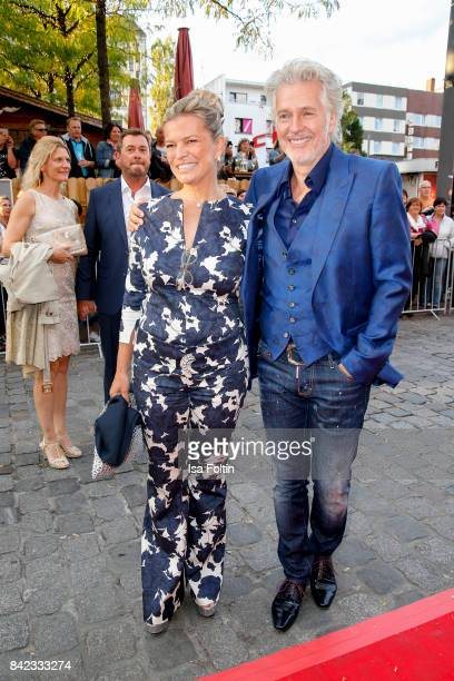 German author Frank Schaetzing and Sabina Valkieser attends the 'Nacht der Legenden' at Schmidts Tivoli on September 3, 2017 in Hamburg, Germany.