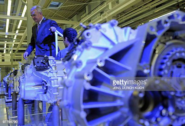 German automaker Volkswagen's CEO Martin Winterkorn walks over an assembly belt of sevengeardual clutch transmission of the type DQ 200 at the VW...