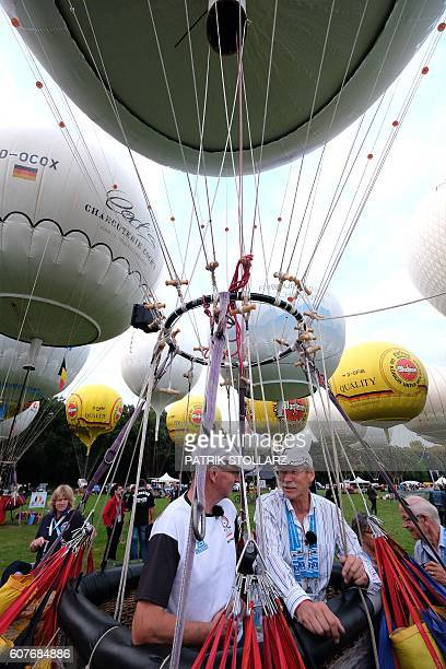 German balloonists Wilhelm Eimers and Matthias Zenge prepare their balloon for the 60th Coupe Aeronautique Gordon Bennett World Long Distance Gas...