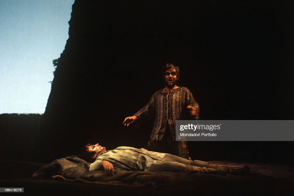 German bass Kurt Moll kneeling beside Bulgarian tenor Spas Wenkoff, playing the role of Tristan, in the opera Tristan und Isolde performed at La Scala. Milan, April 1978.