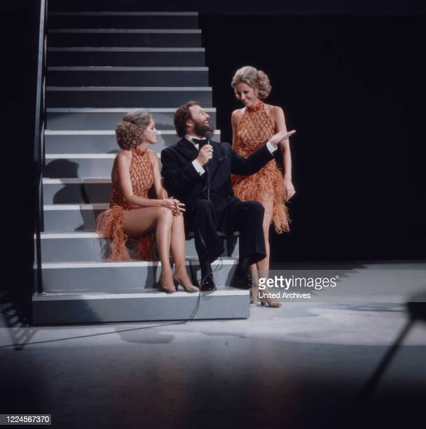 German bass vocalist Ivan Rebroff performing at the ZDF program Musik trumps with the two Kessler twins, Germany, 1975.
