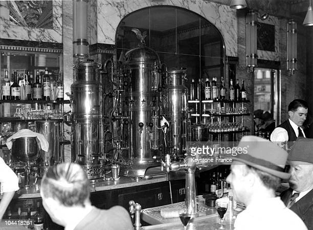 German beer waitress behind a bar in a Paris cafe in 1930