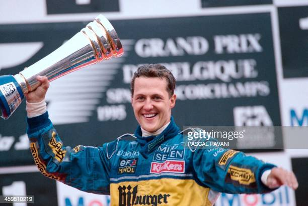 German Benetton-Renault driver Michael Schumacher jubilates on the podium after winning the Formula One Grand-Prix of Belgium on August 27, 1995 in...