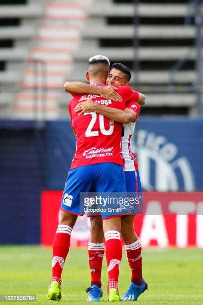 German Berterame of Atletico San Luis celebrates with teammate Mauro Quiroga after scoring the first goal of his team during the 1st round match...