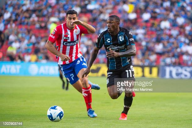German Berterame of Atletico San Luis fights for the ball with Fabian Castillo of Queretaro during the 7th round match between Queretaro and Atletico...