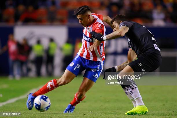 German Berterame of San Luis fights for the ball with Gabriel Hachen of Juarez during the 8th round match between Atletico San Luis and FC Juarez as...