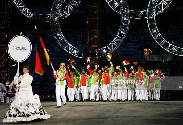 German biathlete athlete Kati Wilhelm carries the German flag in front of her teammates during the Opening Ceremony of the Turin 2006 Winter Olympic...