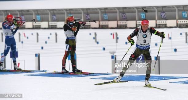 German Biathlete Laura Dahlmeier leaves the shooting range ahead of Franziska Hildebrand from Germany and Eva Puskarcikova from Czech after the last...