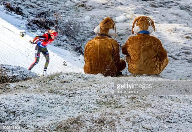 German biathlon fans watch the second placed German competitor Maren Hammerschmidt during the women's 7,5 km sprint event during IBU World Cup in...