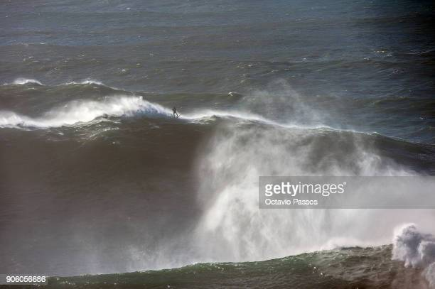 German big wave surfer Sebastian Steudtner drops a wave during a surf session at Praia do Norte on January 17 2018 in Nazare Portugal
