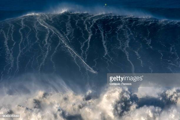 German big wave surfer Sebastian Steudtner drops a wave during a surf session at Praia do Norte on January 18 2018 in Nazare Portugal