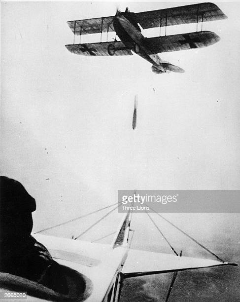 A German biplane drops a bomb
