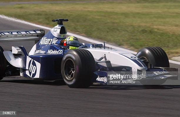 German BMW-Williams driver Ralf Schumacher steers his car on the Hungaroring racetrack near Budapest, 24 August 2003, during the Hungarian Formula...
