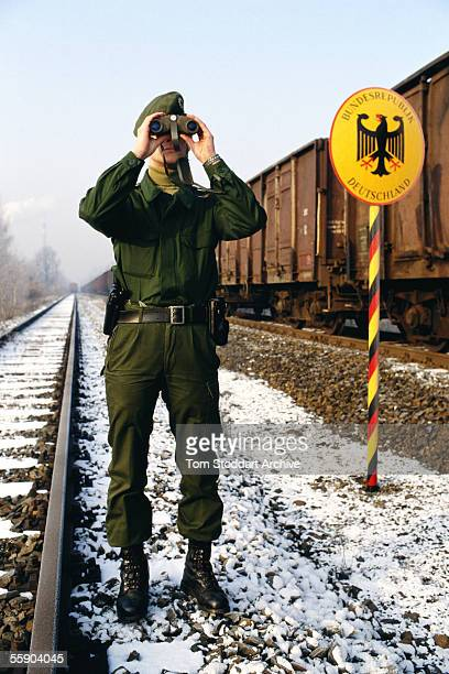 German border policeman searches for illegal immigrants crossing from Poland into Germany at Guben Germany